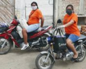 Two Kiya staff delivering aid on motorbikes image