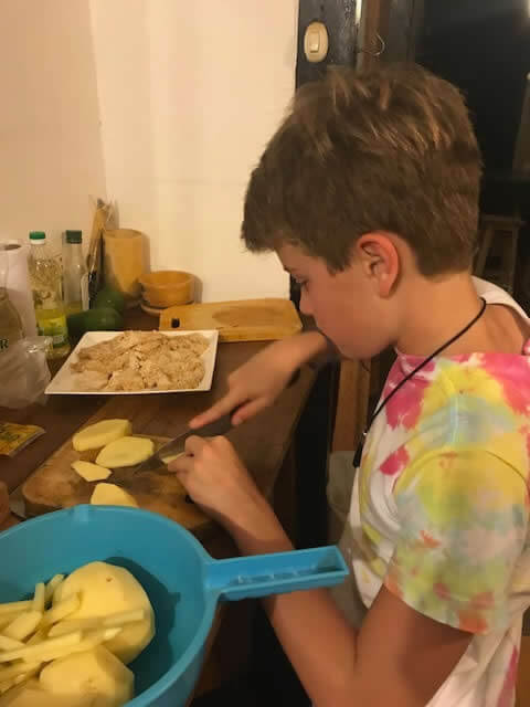 Boy volunteer preparing chips image