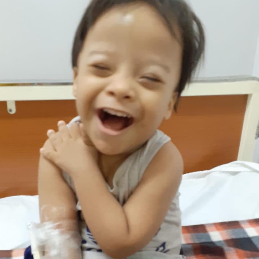 Laughing Kiya Survivor Child image
