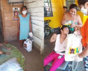 Children receiving their life boxes from Kiya volunteer
