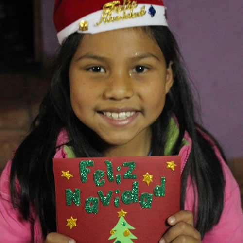 Smiling girl holding Christmas card image